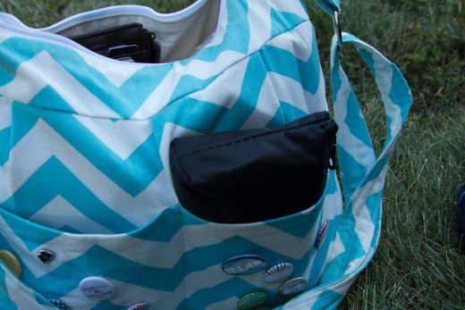 I have two even deeper exterior pockets in my SLR camera bag.