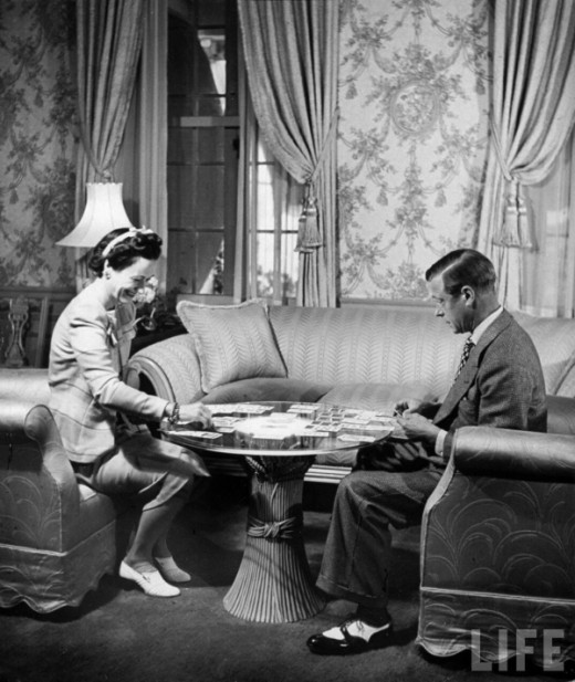1941, Nassau, Bahamas — The Duke Windsor, and his wife the Duchess, playing a card game in their home. — Photograph by David E. Scherman for LIFE