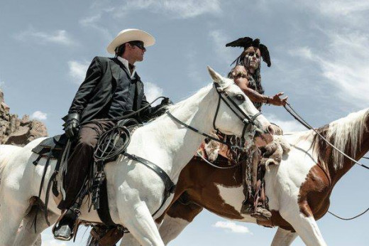 The Lone Ranger and Tonto ride together.