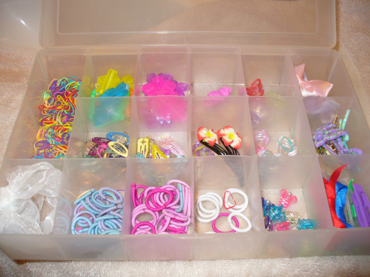 Use divided containers to keep hair accessories neat and organized.