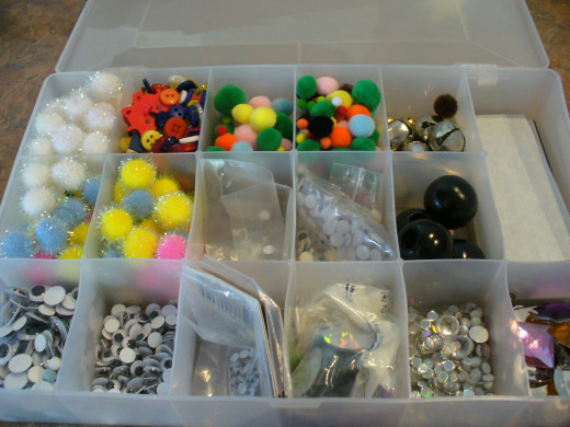 Finding small craft supplies is quick and easy when they are organized in a divided container.