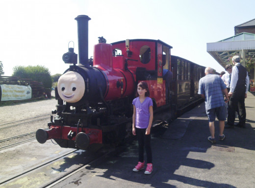 Ellie stood by 'Duncan' the train.