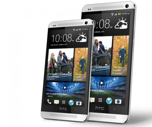 The HTC One Mini next to its bigger brother the HTC One