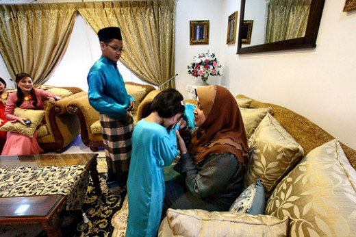 Children seeking forgiveness from their elders - a customary practice during the first day of Hari Raya Puasa