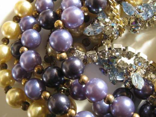 Pearls of varying colours.