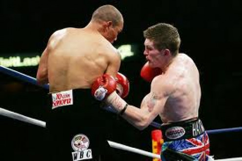 Ricky Hatton is seen here knocking out Jose Luis Castillo with a left hook to the body. Hatton, From England, was a former jr. welterweight and welterweight champion.