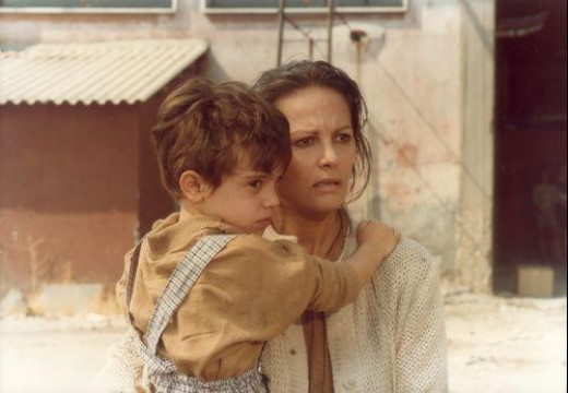 Ida (Claudia Cardinale) with the little Useppe in the Comencini's film (1986).