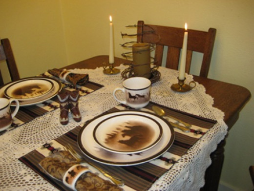 This western dining table is an example of how place settings are laid using more than one serving plate.