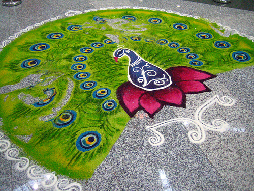 A kolam decoration during Deepavali. Kolam is a form of artwork that involves using coloured rice, chalk or small stones arranged to form a clear picture or pattern, usually on the floor