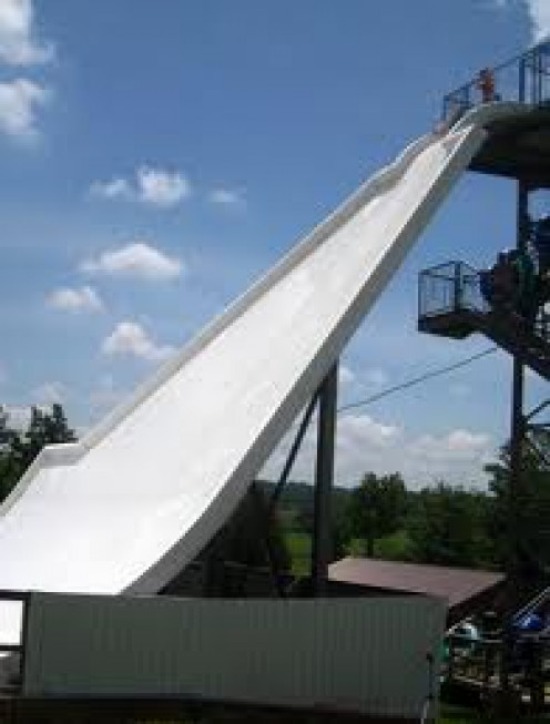 This slide is over 150 feet tall and the rider sits on an inner tube. As you travel down the side your raft goes left to ride at a brisk pace.