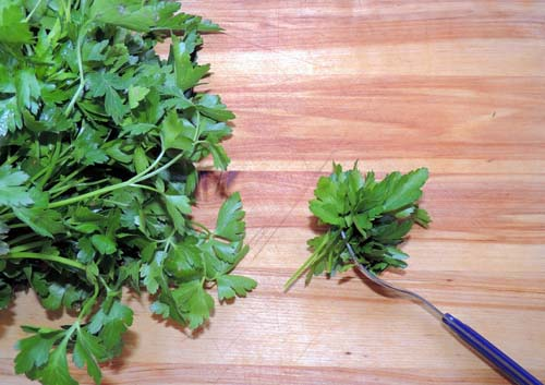 prep the parsley by running a fork through the leaves, like a comb through a hair snarl...