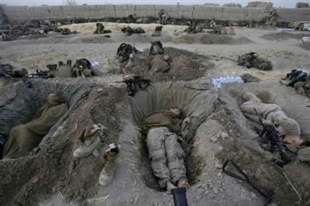 Soldiers sleep in ditches as protection against bomb blasts.