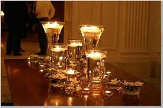 Candles can warm up your wedding and make it look romantic.