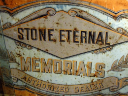 This antique stone memorial maker's sign is available for purchase from Pandoras Parlor