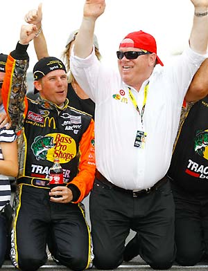 Ganassi celebrating an Indy win with Jamie McMurray