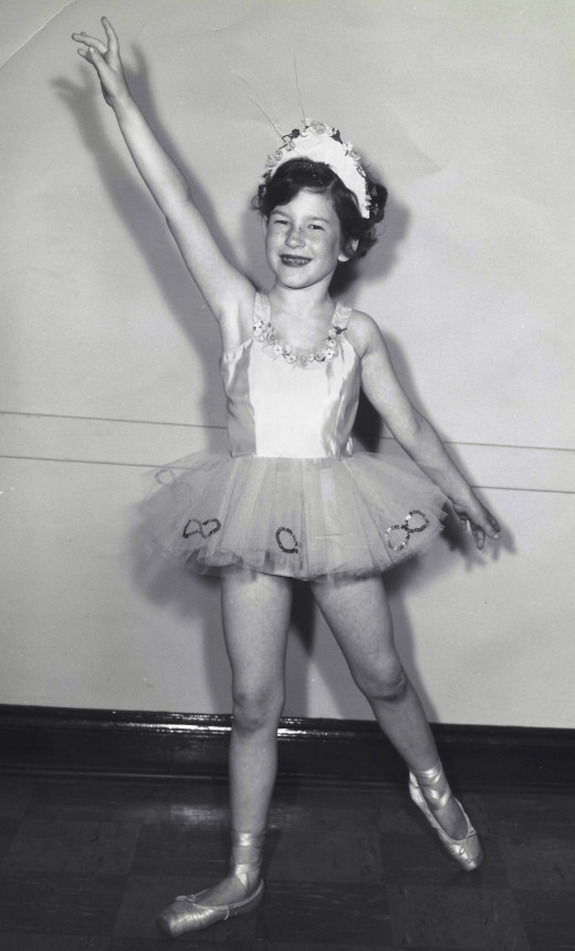 Me around age 8 before a performance - my first year of pain in pointe shoes