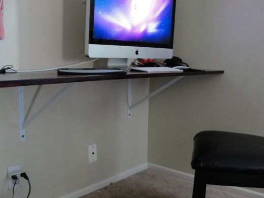 This wall mounted desk may not be the most attractive, but it's a breeze to clean up around.
