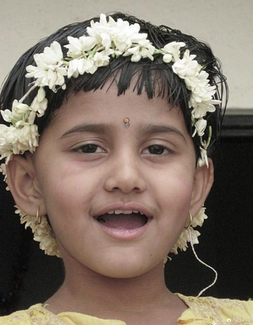 A girl wearing flower headband