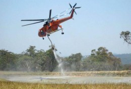 Air crane picks up another load of water