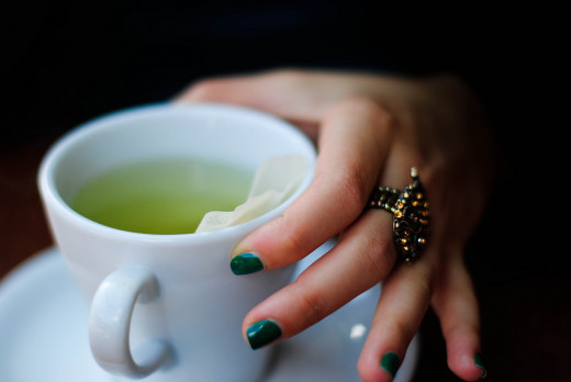 Green tea has polyphenols, an antioxidants that fights off free radicals that can damage brain cells.