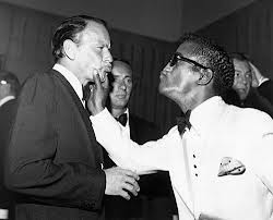 Frank Sinatra and Sammy Davis Jr.  It was Frank who opened doors for Sammy in the entertainment business.  Sinatra refused to perform until Las Vegas moguls allowed Sammy on stage with him.