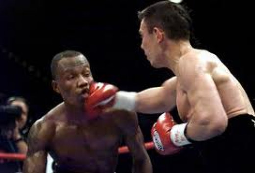 Kostya Tszyu knocks out Zab Judah in two rounds to unify the Jr. Welterweight crown in a minor upset.