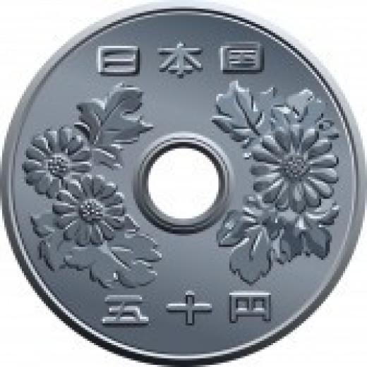 Chrysanthemum flower depicted in Japan Money
