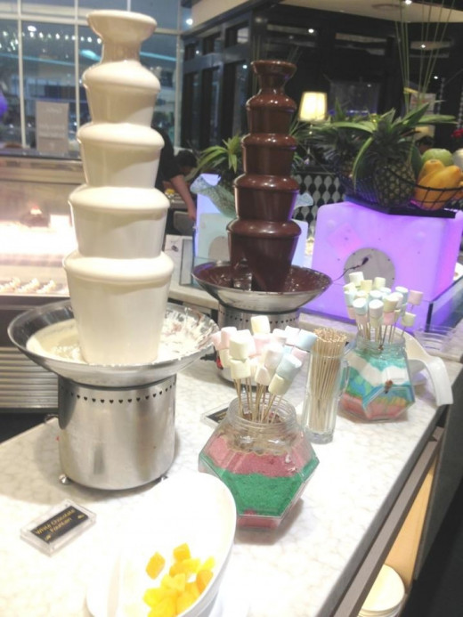 Chocolate fountain, white chocolate as well. You can dipped fresh fruits or mallows in it.