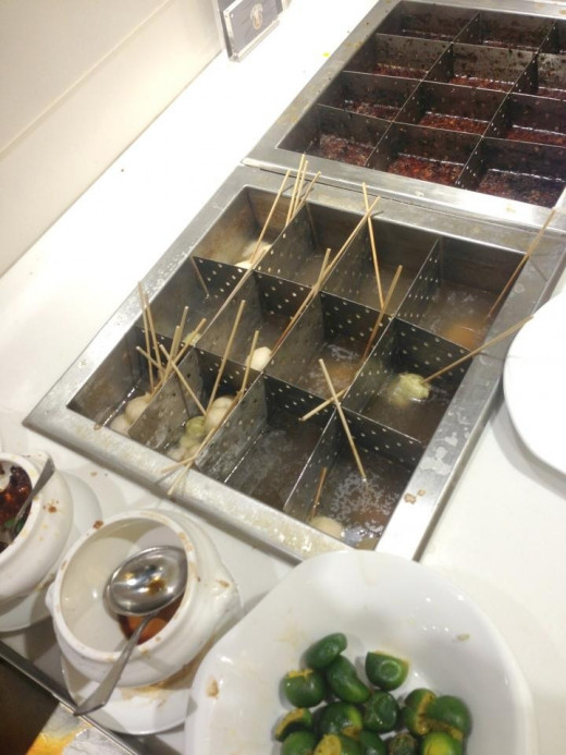 Chinese station, they have different foods on stick, steamed and fried.