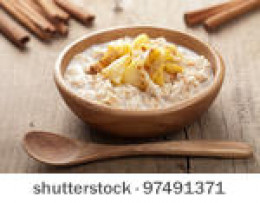A healthy bowl of hot oatmeal with fruit.  Plenty of fiber and good source of protein.