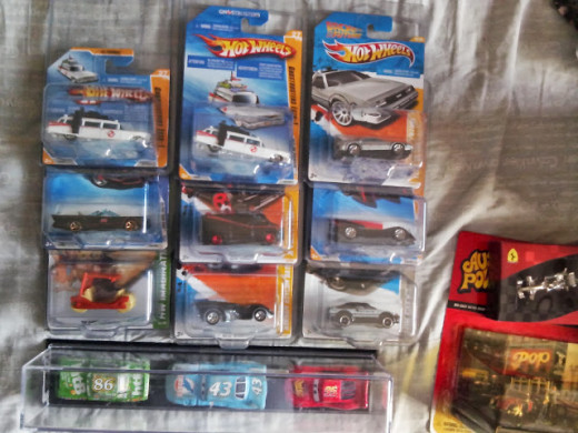 Assorted movie car diecast - Ghostbusters, batmobiles, CARS, etc...