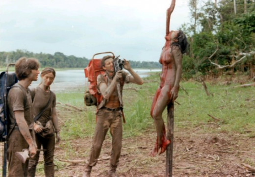 The documentary film crew finds an impaled native