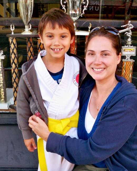 My son and I after he earned his Yellow Belt in Karate in 2011.