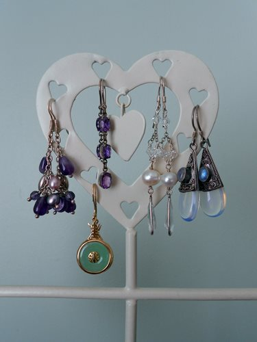 Dangly earrings are kept neatly together on my display stand!