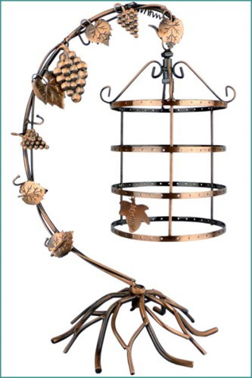 This pretty earring stand will display up to 72 pairs of earrings in the four tier rotating bird cage - it also has five hooks on the main arm to hang necklaces and bracelets (see product link below)