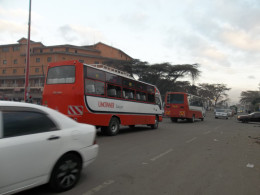 Two UMOINNER buses, members of one of the numerous franchises, rushing to Umoja estate to pick passengers