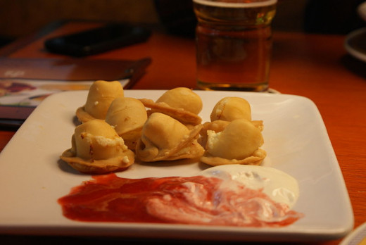 stuffed dumplings made of unleavened dough in Belarusian, Lithuanian, and Polish cuisines