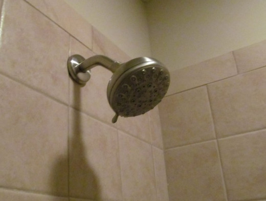 Hotel room showers are in use constantly.  Water pressure and temperature may vary.