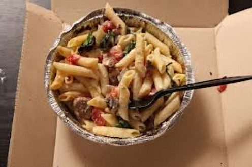 The chicken carbonara dish has chicken, mushrooms, spinach, pasta noodles and cheese.