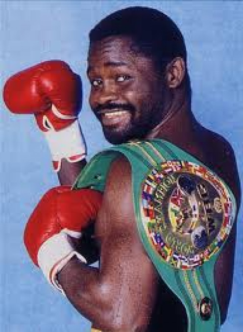 Azumah Nelson displays his WBC Championship belt. He is known as The Professor and he could end a fight at any moment.
