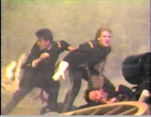 Custer tries to shield his unarmed friend Devin from artillery fire at the climax of 'Class of '61.'