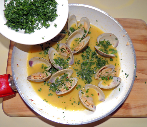 once clams pop, remove clam mixture from heat, and sprinkle parsley