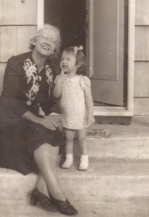 My great-grandmother with my aunt enjoying a private delight.