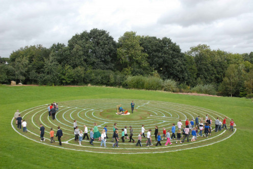 A class of students walking The Labyrinth for Peace.