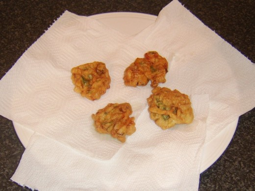 Draining deep fried bell pepper fritters