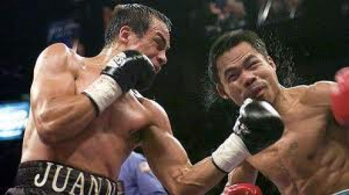 Manny Pacquiao won a close disputed 12 round decision over Juan Manuel Marquez in their second bout. All of their fights were very competitive and fought on even terms.