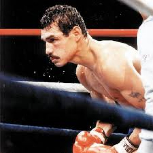 Alexis Arguello prepares for another round of action. He had one punch knockout in both hands and he showed it on Many occasions.