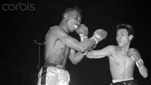 Flash Elorde defeated Sandy Saddler in a Jr. Lightweight title tilt. Both boxers are Hall of Fame legends in their own right.