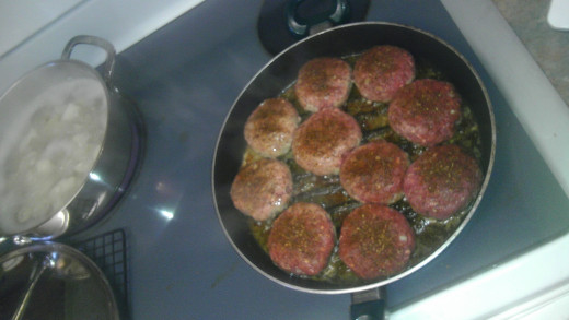 Cooking the burgers at a slow but steady temperature.