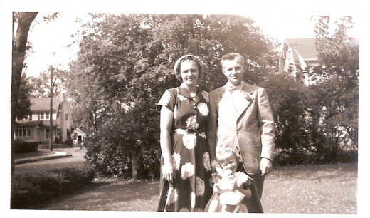 My mother, father and me with my doll.